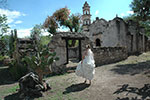 bride alone at the rustic chapel